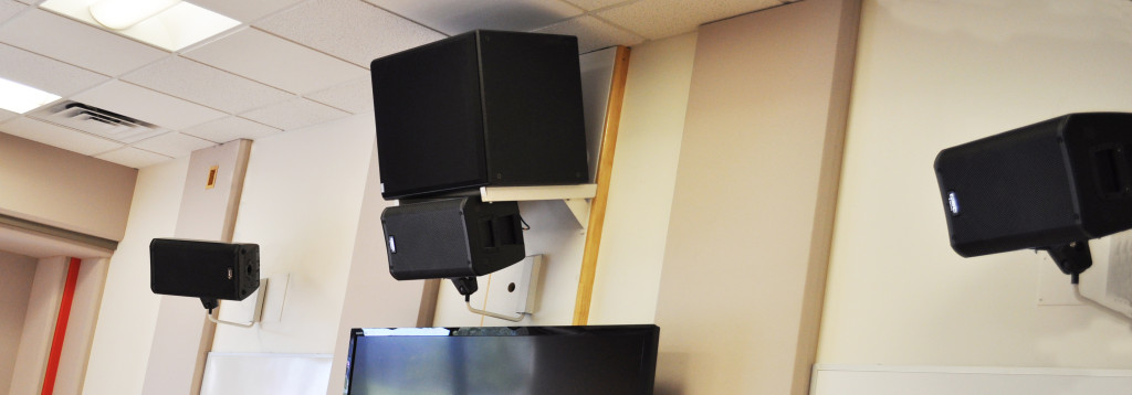 Front wall speakers on a 5.1 surround system in a music classroom.